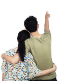 young-couple-pointing-wall-back-view-isolated-over-white-background-36025724